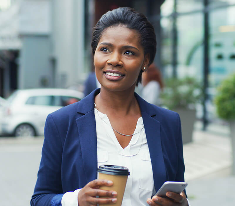 Woman appearing confident with coffee and cell phone